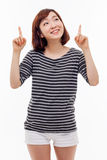 Smiling young woman pointing upwards Stock Photos