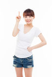 Smiling young woman pointing upwards. Isolated on white background Royalty Free Stock Images