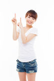 Smiling young woman pointing upwards Stock Image