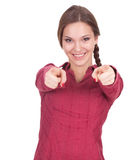 Smiling young woman pointing you Stock Photos