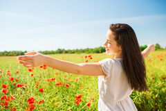 Smiling young woman on poppy field Stock Photography