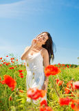 Smiling young woman on poppy field Stock Photos