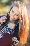 Smiling young woman portrait in warm sunset light Stock Photos