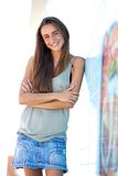 Smiling young woman posing with arms crossed Stock Photography