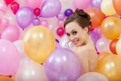 Smiling young woman posing with balloons Royalty Free Stock Image