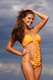 Smiling Young Woman Posing Outdoors in Swimsuit stock images