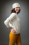 Smiling young woman posing in a studio wearing in a sweater Royalty Free Stock Photography