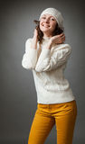 Smiling young woman posing in a studio wearing in a sweater Stock Photography