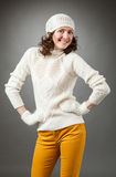 Smiling young woman posing in a studio wearing in a sweater and Stock Image