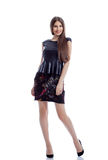 Smiling young woman posing in trendy clothes Royalty Free Stock Images