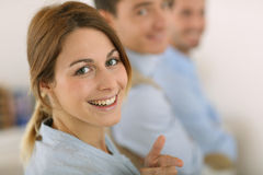Smiling young woman with a positive look Stock Photo
