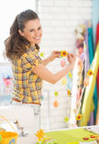 Smiling young woman preparing for easter Stock Photo