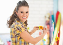 Smiling young woman preparing for easter Royalty Free Stock Photography