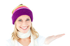 Smiling young woman presenting Royalty Free Stock Photography