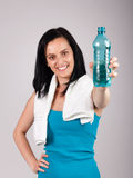 Smiling young woman promoting water Stock Images