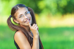 Smiling young woman put finger Stock Photo