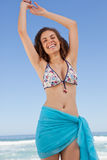 Smiling young woman raising her arms to show her happiness Royalty Free Stock Photography