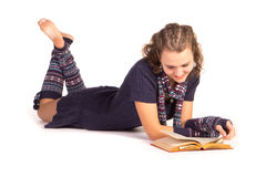 Smiling young woman reading a book Stock Images