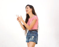 Smiling young woman  reading text message on cell phone Stock Photos