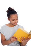 Smiling Young Woman Reading a Yellow Book. Close up Smiling Young Asian Indian Woman in Casual Shirt Reading a Yellow Book, Isolated on White Background Royalty Free Stock Image