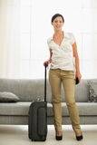 Smiling young woman ready for trip Royalty Free Stock Photography