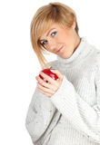 Smiling young woman with red apple Stock Images