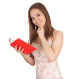 Smiling young woman with red book Royalty Free Stock Photos