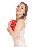 Smiling young woman with red book Stock Photos
