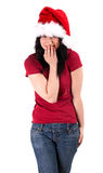 Smiling young woman in red Christmas hat Stock Photography