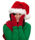 Smiling young woman in red Christmas hat Royalty Free Stock Image
