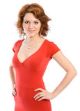 Smiling young woman in red dress. Studio shoot on white background Royalty Free Stock Photography
