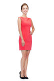 Smiling young woman in red dress Royalty Free Stock Photography