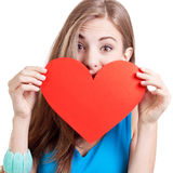 Smiling young woman and red heart love stock photography