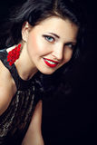 Smiling young woman with red lips and blue eyes Stock Image