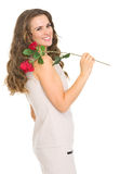 Smiling young woman with red rose. Isolated on white Royalty Free Stock Images