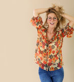 Smiling young woman with red round eyeglasses Stock Images