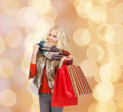 Smiling young woman with red shopping bags Stock Photos