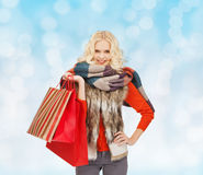 Smiling young woman with red shopping bags Stock Images
