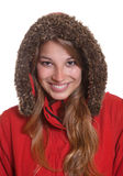 Smiling young woman in a red winter coat Stock Image