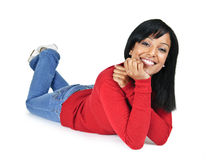 Smiling young woman relaxing laying down royalty free stock image