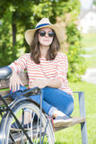 Smiling young woman relaxing outdoor Royalty Free Stock Photography