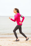 Smiling young woman running outdoors Royalty Free Stock Photos