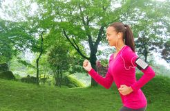 Smiling young woman running outdoors Royalty Free Stock Photography