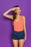 Smiling Young Woman Salute Stock Photo