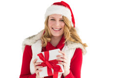 Smiling young woman in santa hat holding a gift Stock Image