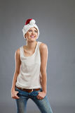 Smiling young woman in santa's hat Royalty Free Stock Photo