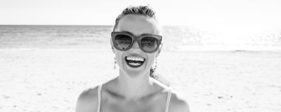 Smiling young woman on seashore royalty free stock photography