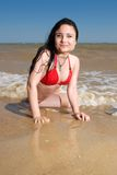 Smiling young woman at the seaside. Positive brunette girl chilling at the sea Stock Photography