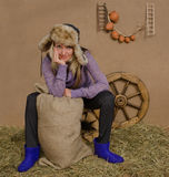 Smiling young woman in a shed with rural interior Royalty Free Stock Images
