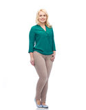 Smiling young woman in shirt and trousers Stock Image